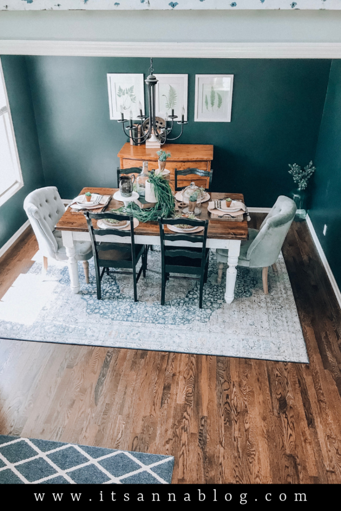 Dining room table and chairs with a cozy rug underneath.